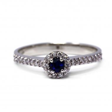 Round ring with sapphire and white diamonds